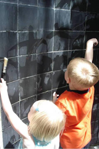 children painting on slate walls of the Secret Room. Image courtesy Carol A. Krawczyk, ASLA