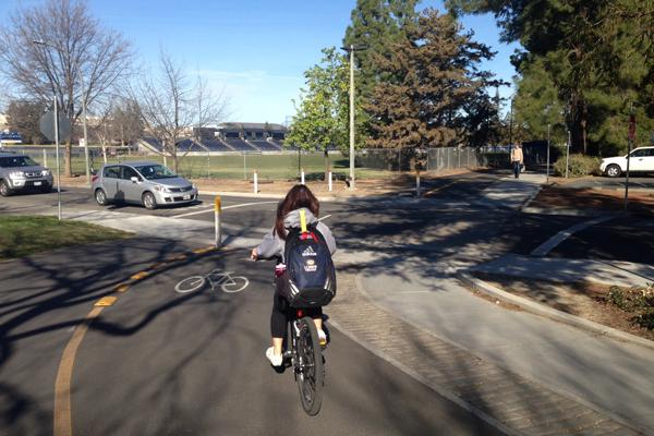 Mid-block road crossing design for bikes and pedestrians image: Skip Mezger