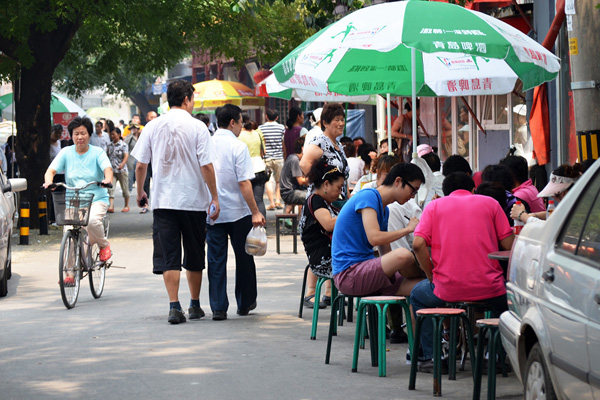 Active hutongs throughout the historic city center image: Shawn Balon