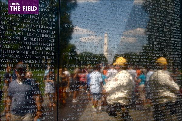 Visitors reflected in the Vietnam Veterans Memorial in Washington, DC image: Alexandra Hay