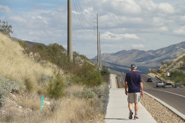 "Figure 6: ""Mohave sage"" finishes on power poles on Sunrise Drive in the Catalina Foothills, a suburban area north of the City of Tucson. Painted finishes are no longer used. image: Ellen Alster"