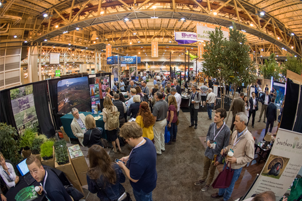 The Planting Design PPN EXPO Tour at J. Frank Schmidt & Son Co.'s booth, where they listened to an overview of efforts to select, test and introduce new tree cultivars and bring underused native and site-adapted species into the marketplace. image: Event Photography of North America Corporation (EPNAC)