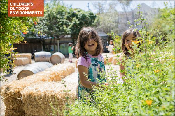 Children playing, green schoolyard, Golestan School