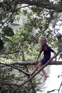 Milly climbing a tree
