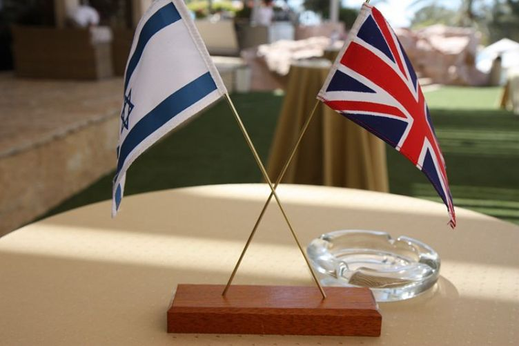 Israeli and British flags on display at the Eilat-Eilot Renewable Energy Conference British Embassy in Israel. Image Source: UK