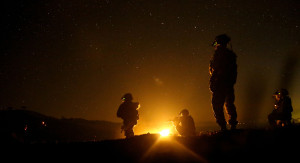 """US Army Rangers training exercise. Image Source: """"MPOTY 2014 U.S. Army Rangers prepare to lay cover fire during task force training"""" by Spc. Steven A. Hitchcock"""