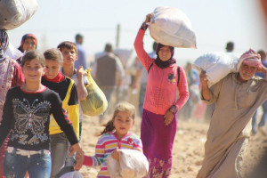 Syrian Kurds headed to Turkey. Image Source: European Commission DG ECHO, Flickr, Creative Commons