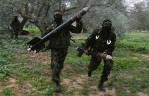 PIJ troops running with rockets. Image Source: Amir Farshad Ebrahimi, Flickr, Creative Commons