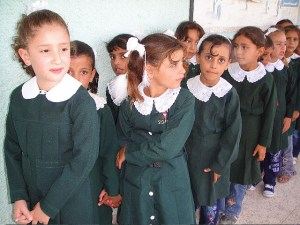 Girls lining up for school in Gaza. Image Source: Al Jazeera English, Flickr, Creative Commons