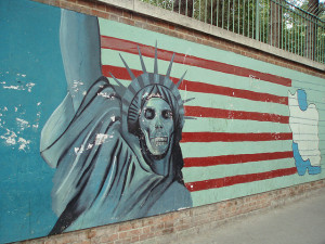 Image Source: DAVID HOLT, Flickr, Creative Commons Iran 2007 025 Famous mural of Statue of Liberty with a skull face in front of an American flag, former US Embassy, Tehran.