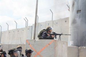 Image Source: Stop The Wall, Flickr, Creative Commons An israeli sniper pointing at the unarmed protest.