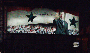 Image Source: DAVID HOLT, Flickr, Creative Commons Syria 2007 008 Damascus Bashar al-Assad