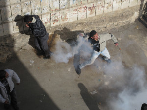 Image Source: Palestine Solidarity Project, Flickr, Creative Commons Demonstrator throws back tear gas grenade. PSP Palestine