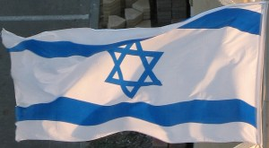 James Emery, Flickr, Creative Commons Israeli flag flapping_0514c One of three Israeli flags on the south side of the Blue Bay hotel in Netanya, Israel
