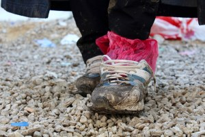 Image Source: Trocaire, Flickr, Creative Commons IMG_4092 Refugee's shoes are worn, wet and muddy after a long journey. These shoes are owned by Ali, a Yazidi refugee who travelled from Iraq to Presevo, Serbia to avoid persecution. Photo: Meabh Smith/Trócaire