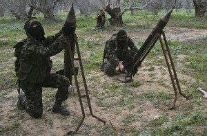 Image Source: Amir Farshad Ebrahimi, Flickr, Creative Commons Israel and Gaza -3 Masked Palestinian militants from Islamic Jihad place homemade rockets before later firing them into Israel on the outskirts of Gaza City,