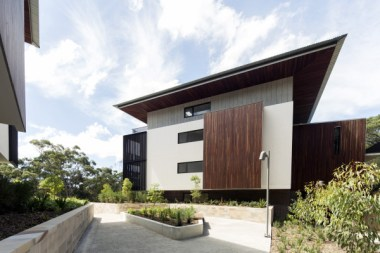 Off corm concrete with spotted gum cladding