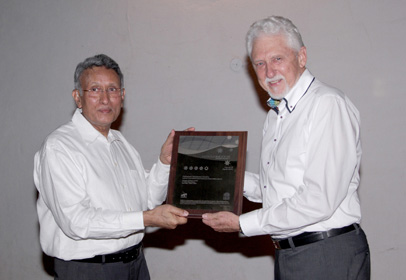 CETEC's Dr Vyt Garnys (right) awarding the NABERS IE rating to PBC's Kamal Meattle.