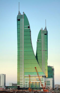 Dino-architecture? Bahrain's twin towers are covered in glass.  Allan Donque, CC BY
