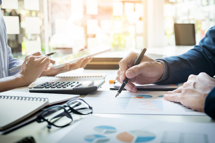 building budgets business man financial inspector and secretary making report, calculating or checking balance. Internal Revenue Service inspector checking document. Audit concept