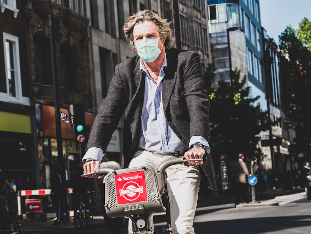 c40 cities emissions man on bike with mask