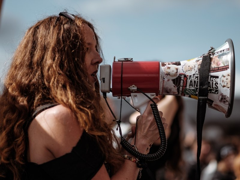 Campaigning groups lead, a lotCampaigning woman microphone