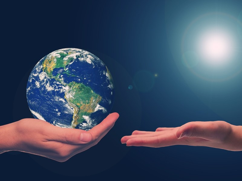 hand holding earth