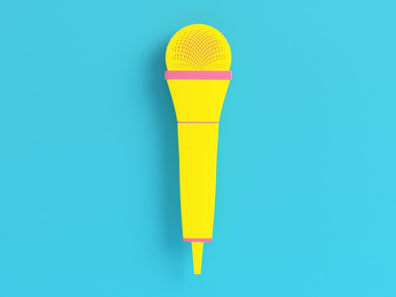 Yellow microphone on bright blue background in pastel colors. Minimalism concept. 3d render