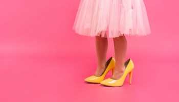 Little girl in oversized high heels
