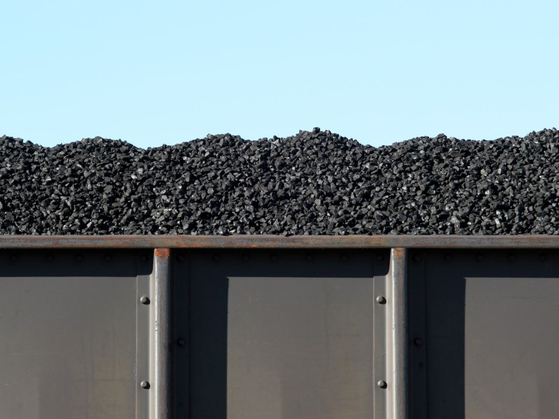 coal in train boxcar awaiting transport