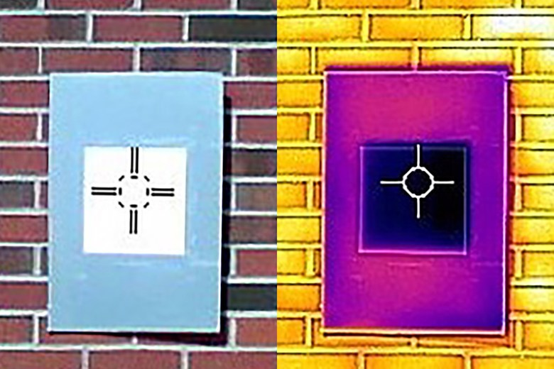 "An infrared camera shows how a sample of the whitest white paint (the dark purple square in the middle) actually cools the board below ambient temperature, something that not even commercial ""heat rejecting"" paints do. (Purdue University/Joseph Peoples)"