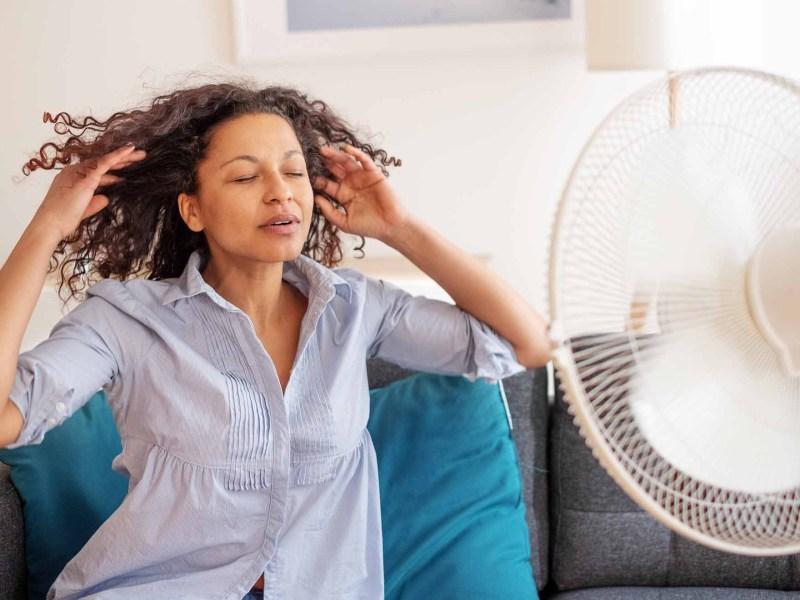 woman in front of fan hot