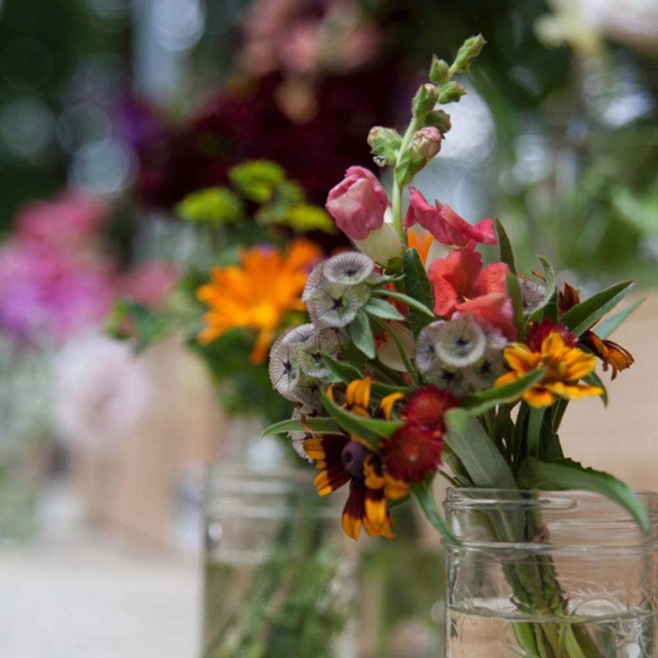 a bouquet of flowers at a farmers market