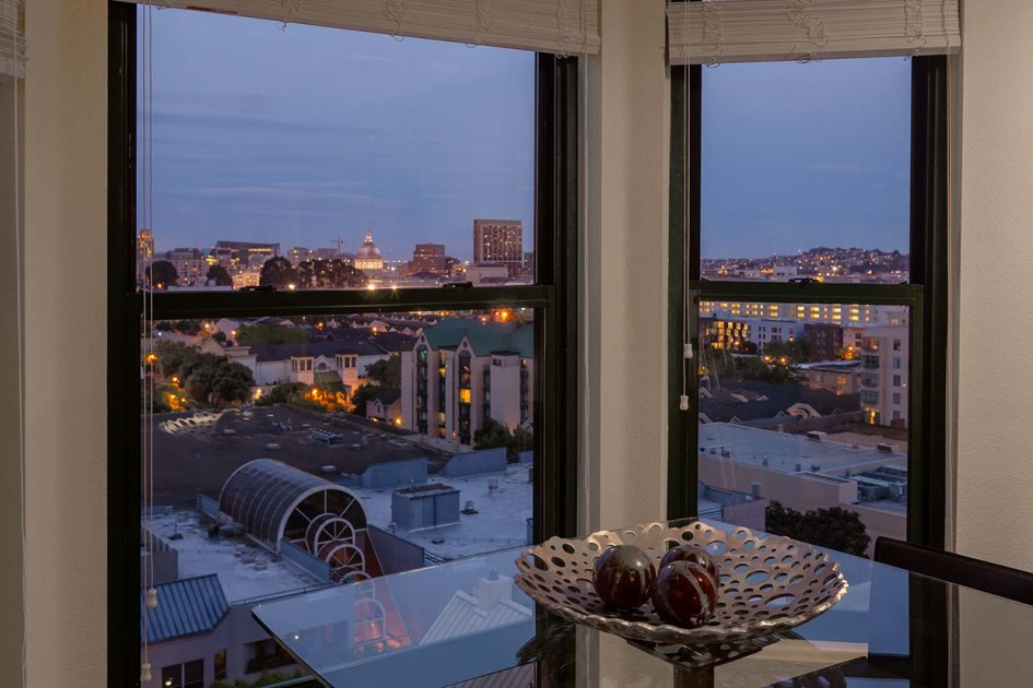 View from the inside of an apartment at the fillmore center at dusk