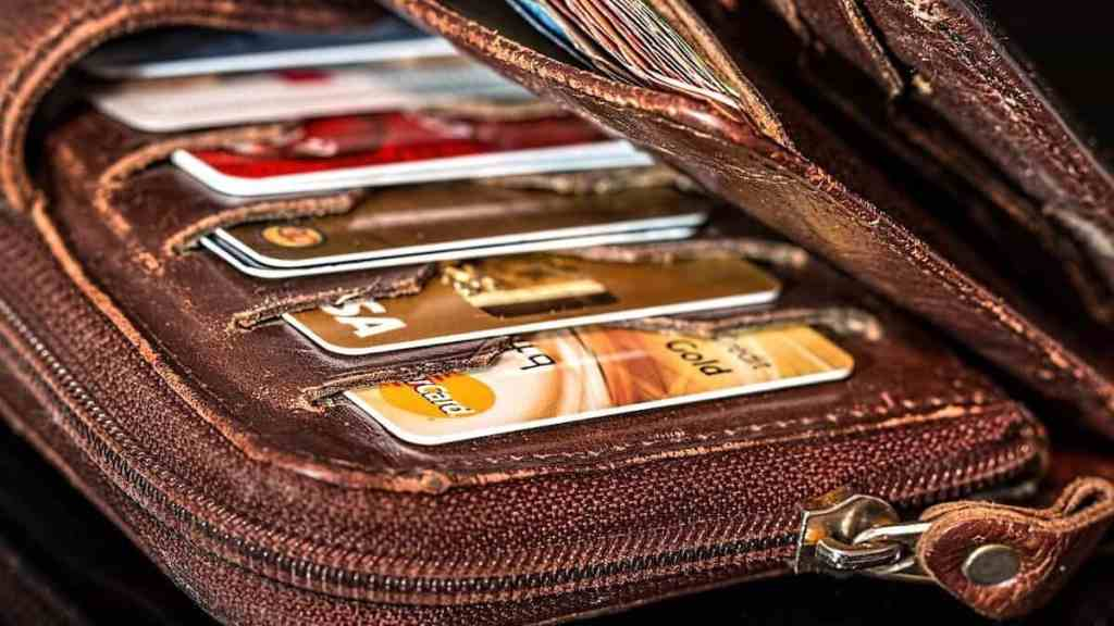 the wallet of someone who is drowning in debt