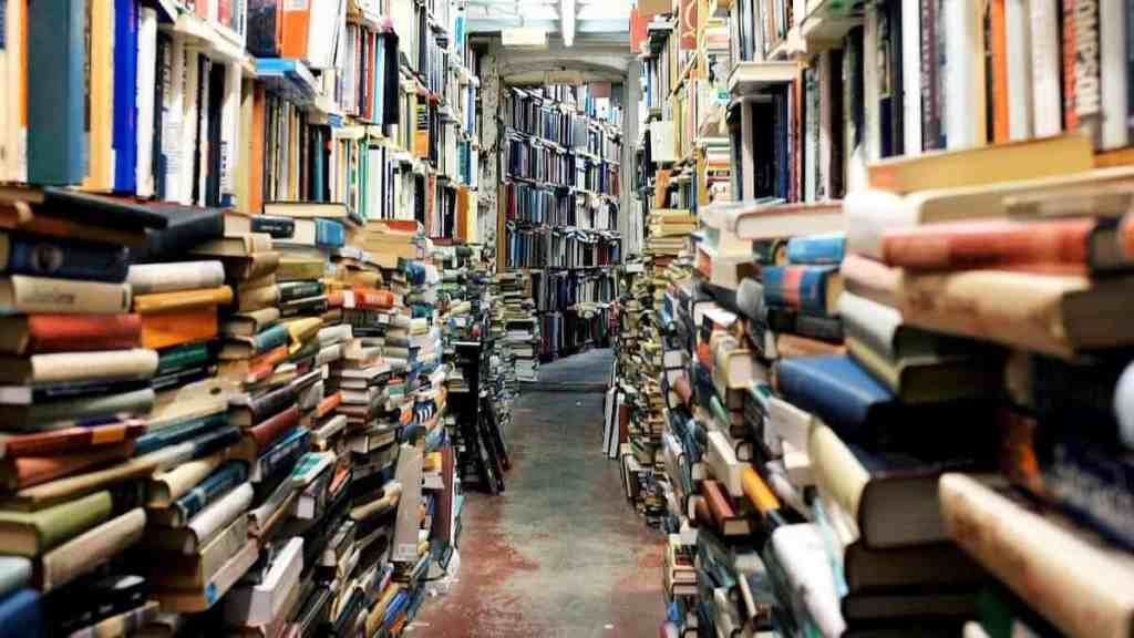 picture of books to do your homework before getting out of a debt spiral