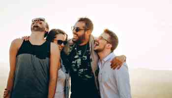 a group of millennials happy about improving their credit scores