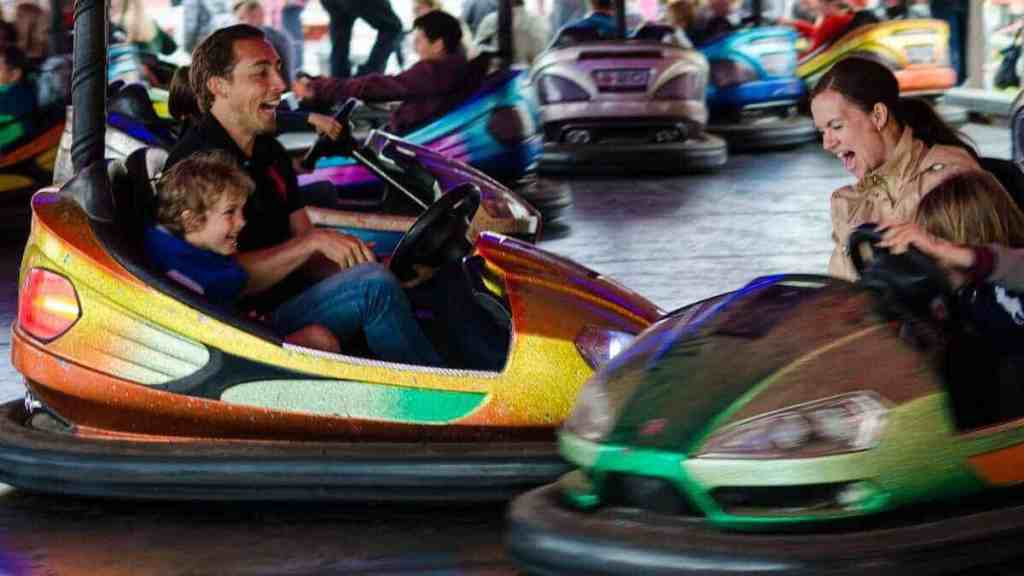 bumper cars with parents and toddlers in a southern california amusement park