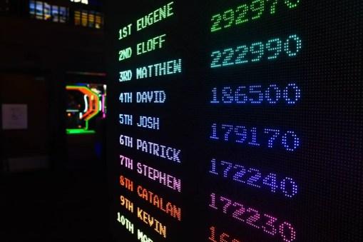 Checking credit score on a glowing scoreboard