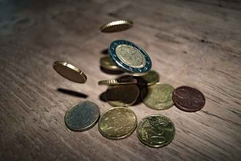 Coins dropping onto the table