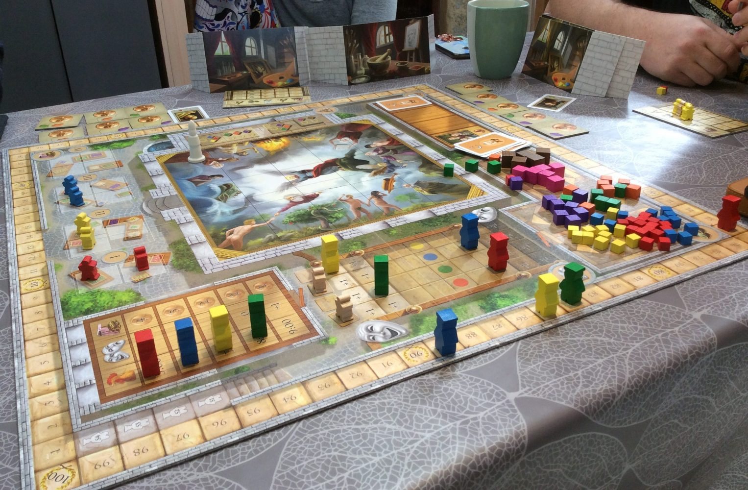 Evocative image: Strategic boardgame featuring a market. Complex. Full of people.