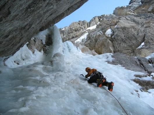 Clint Helander navigates steep ice on the first ascent of Mount Mausolus. Revelation Mountains, Alaska. Photo: Scotty Vincik