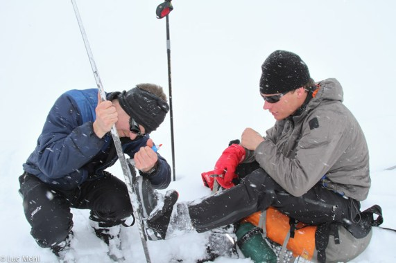 Brad Marden trying to help Eben Sargent de-ice his bindings, 2011 Alaskan Mountain Wilderness Ski Classic, Brooks Range.