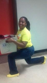 Lashonda K. of Berkley, CA performs LUNGE TWISTS down a school corridor with files, yes!