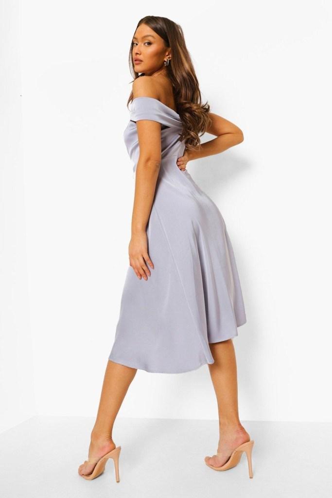 girl wearing blue satin occasion wear midi dress for a wedding