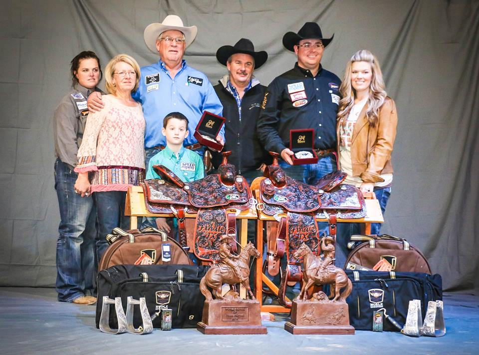 John Coltharp celebrates with his partner and their families following their $300,000 victory in the World Series of Roping in Las Vegas. || Photo from Spin to Win Rodeo Magazine