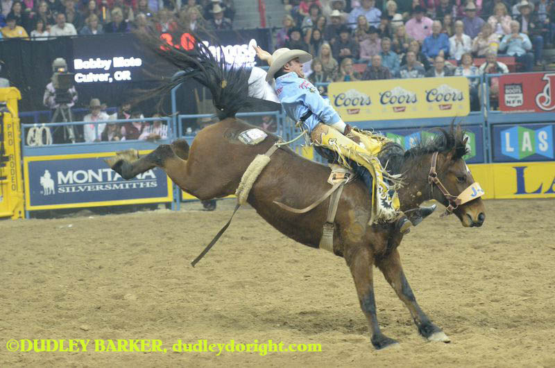 Bobby Mote placed second in the bareback riding  with Tuesday's score of 83 on Turkish Whiskey. More importantly, he jumped to the top of the pack in the average through six rounds at the 2014 Wrangler National Finals Rodeo. || Photo by DUDLEY BARKER, dudleydoright.com