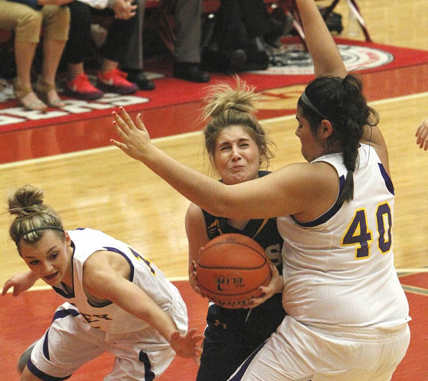 Robbi Elliott expresses her dismay at running into a Godley defender in Saturday's tournament championship in Glen Rose. || Photo by RUSSELL HUFFMAN