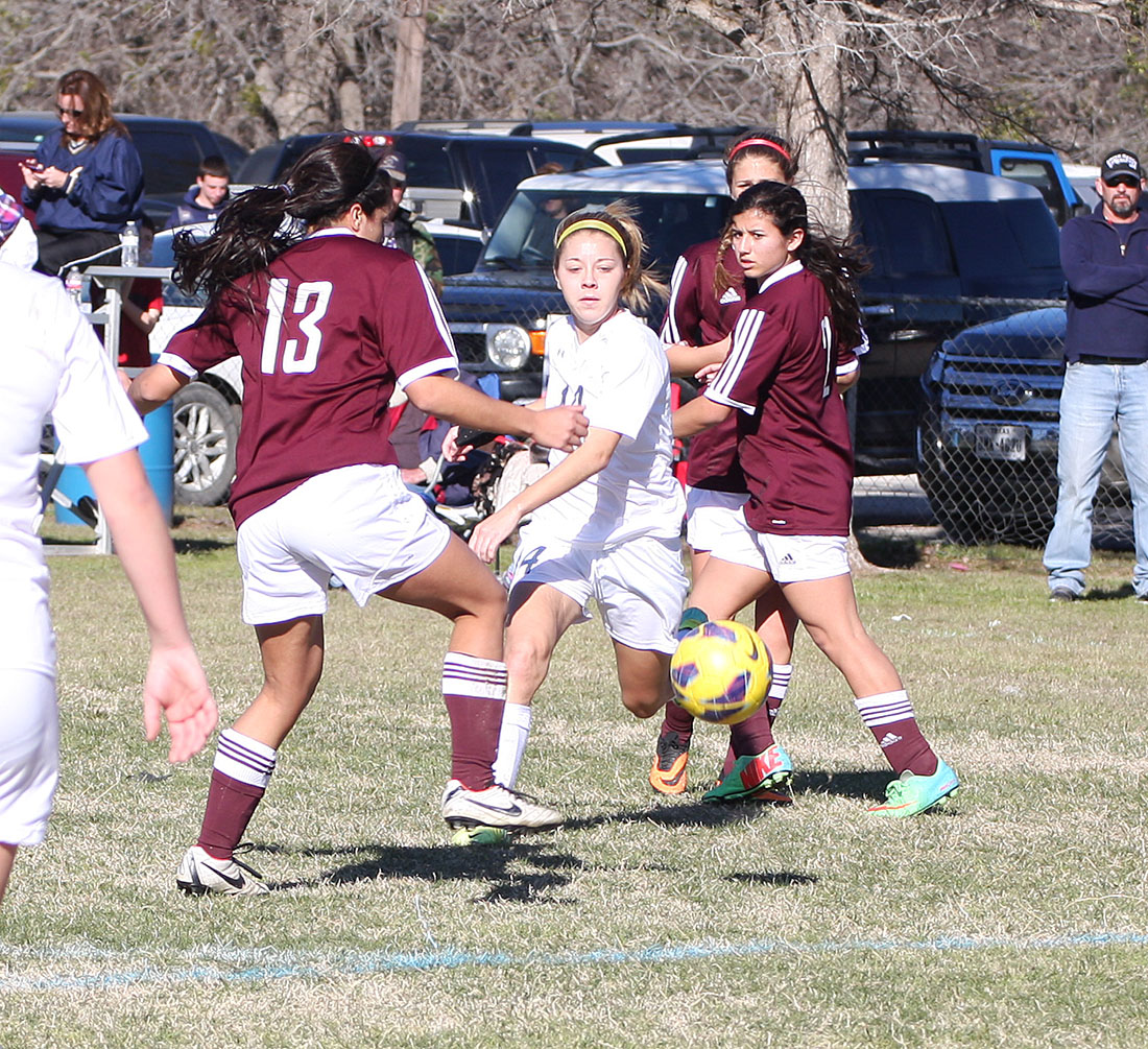 All-tournament selection Bayleigh Chaviers splits two Brownwood defenders in the semifinal round Saturday afternoon.    Photo by BRAD KEITH