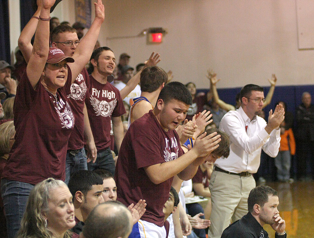 The crowd was intense - often raucous - at jam-packed Huckabay High School Friday.    Photo by BRAD KEITH